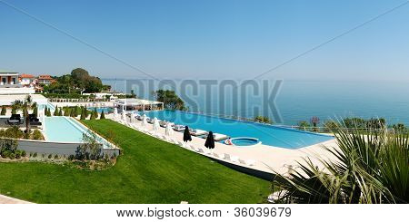 Panorama Of Infinity Swimming Pool By Beach At The Modern Luxury Hotel, Pieria, Greece