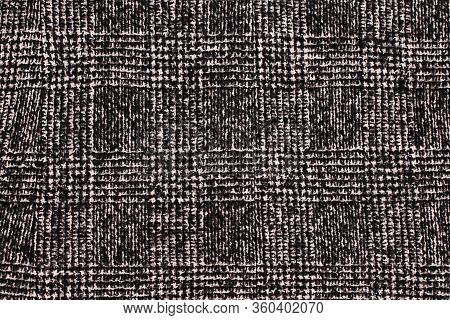 Black And White Cage Texture Fabric. Wool Background Texture. Coat Close-up. Expensive Women's Coat.