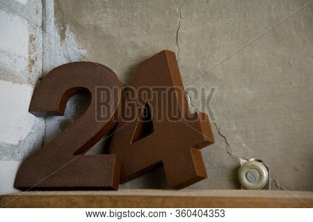 The number 24 as a metal number on a shelf