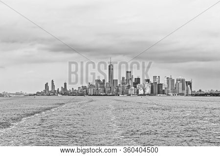 Dramatic Manhattan Island Panorama During The Gloomy Weather From The Staten Island Ferry In New Yor