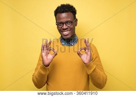 Portrait Of Happy African American Man In Glasses Showing Ok Sign And Smiling