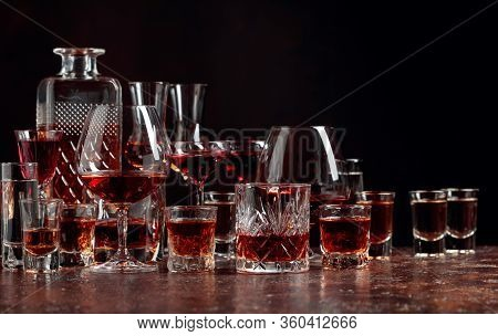 Set Of Strong Alcoholic Drinks In Glasses On A Dark Background. In The Presence Of Liquor, Whiskey,