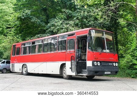Sochi, Russia - July 25, 2009: Red Touristic Coach Bus Ikarus 256 In The City Street.