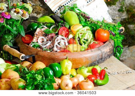 Still Life From Vegetables And Meat On The Earthen Dish