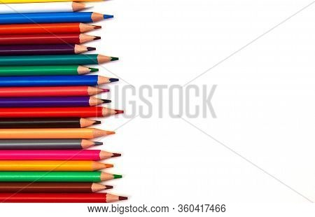 Multi-colored Wooden Pencils From The Right With An Empty Space For Text On A White Isolated Backgro