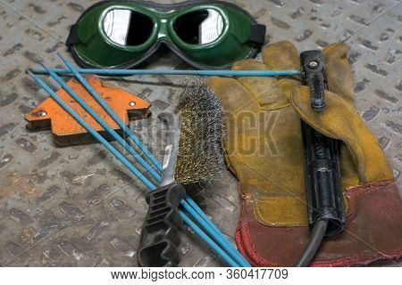 Welding Machine, In The Workshop, Welding Mask, Leather Gloves, Welding Electrodes, High-voltage Wir