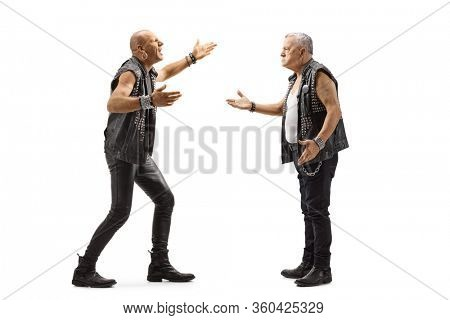 Full length profile shot of two angry punk men having an argument isolated on white background