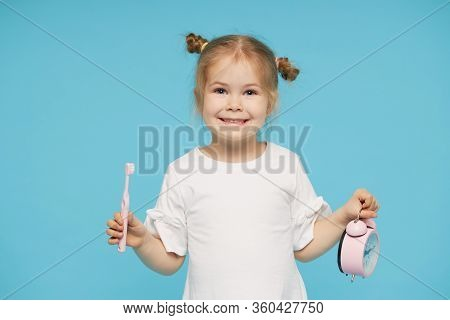 Oral Hygiene. Time To Brush Your Teeth. Little Child Girl Brushing Her Teeth With A Toothbrush And L