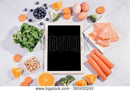 Foods That Help Maintain Eyes Healthy, Products For Keeping Good Vision. Black Board With Copy Space