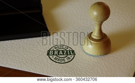 Made In Brazil Stamp And Stamping Hand. Factory, Manufacturing And Production Country Concept.