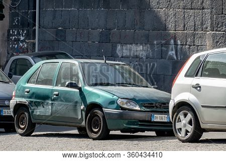 Catania, Sicily - February 12, 2020: The Damaged Small French Citroen Saxo Hatchback After A Car Acc