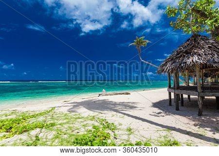 Lalomanu beach with open huts called fales, south side of Upolu Island, Samoa.