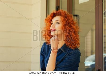 Thinking About New Job New Life. Beautiful Red Head Curly Woman Person Girl Looking Up Thinking Abou