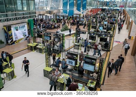 Skolkovo, Russia - October 21, 2019: Visitors to the business forum move around the exhibition space, top view