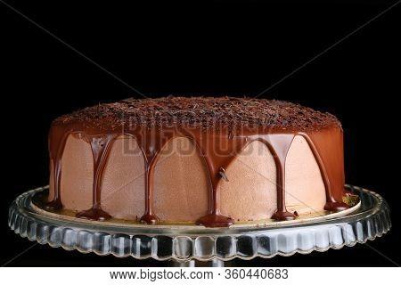 Caramel Drip On Cake Closeup. Mousse Caramel Cake With Caramel Topping And Grated Chocolate Closeup.