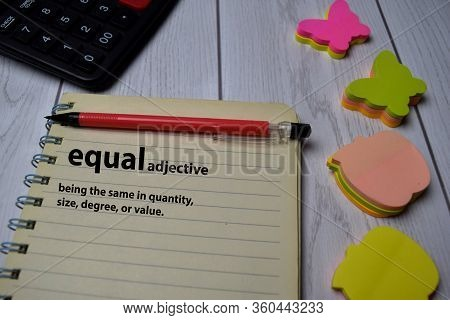 Definition Of Equal Word With A Meaning On A Book. Dictionary Concept