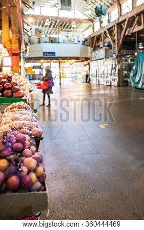 Vancouver, Canada - Apr 7, 2020: Produce Shopper In Empty Granville Island Market Artisan Space Duri