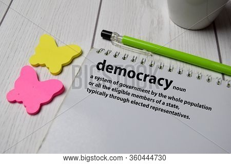 Definition Of Democracy Word With A Meaning On A Book. Dictionary Concept