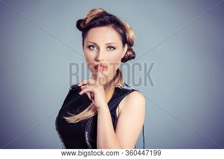 Woman Wide Eyed Asking For Silence Or Secrecy With Finger On Lips Hush Hand Gesture Blue Grey Backgr
