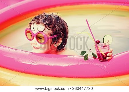 Children Playing In Pool. Summer Holidays And Vacation Concept. Children Play In Tropical Resort. Ch