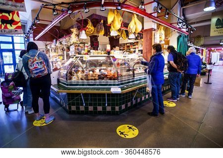 Vancouver, Canada - Apr 7, 2020: People Purchasing Meat Products At Granville Island Market During C