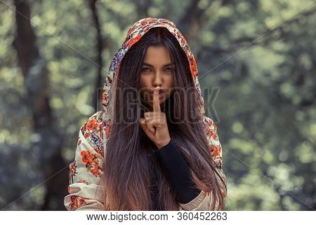Woman Wide Eyed Asking For Silence Secrecy With Finger On Lips Hush Hand Gesture  Isolated Green Bac