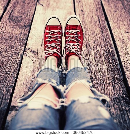 Red Sneakers On Wooden White Floor Background, Top View. Conceptual Image Of A Dancing Couple, Youth