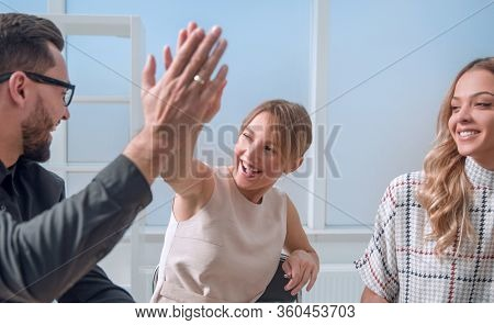 close up.business team giving each other a high five.