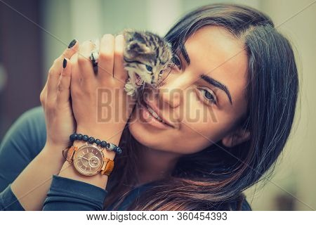 Pets Care. Young Woman Holding Showing Cat Home Looking At You Camera Smiling. Closeup Striped Cute