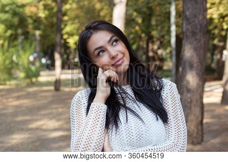 Closeup Portrait Of Cute Pretty Smiling Young Woman, Student Thinking Hand On Chin Looking Up Having