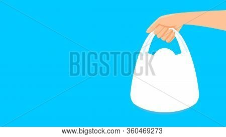 Bag Plastic And Hand Holding Isolated On Blue Background, Clip Art Plastic Bag Handle, Copy Space Te