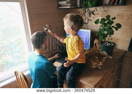 Father Freelancer Try Work From Home Office In Quarantine, Child With Cat Sits Near And Plays, Conce