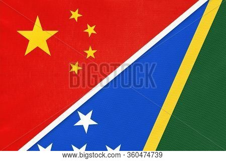 China Or Prc Vs Solomon Islands National Flag From Textile. Relationship Between Asian And Oceania C