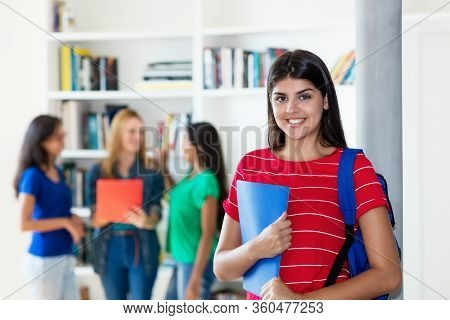 Laughing Hispanic Female Student With Group Of Multi Ethnic College Students At Classroom Of Univers