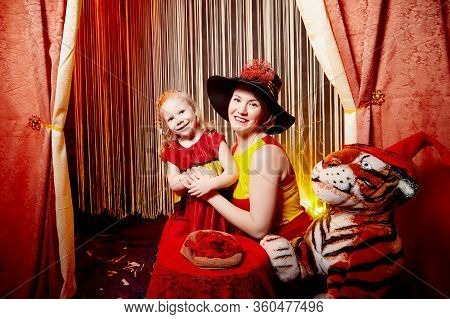 Family During A Stylized Theatrical Circus Photo Shoot In A Beautiful Red Location. Models Mother An