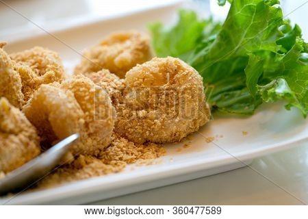Deshelled Prawns Fried With Golden Salted Egg. Crispy Exterior Fried Prawns, Whilst Preserving The T