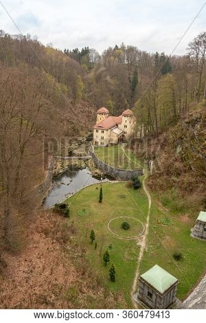 Lesna, Poland - April, 2019: Small Hydropower Plant Lesna, View Of The Dam And The Room With Hydro T