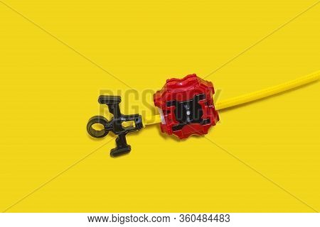 Set Of Popular Kid Toys Over Yellow Background. Ring, Launcher, Gyroscope