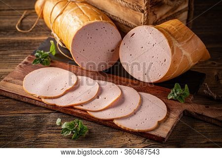 Delicious Deli Meats On Wooden Cutting Board, Rustic Wooden Background