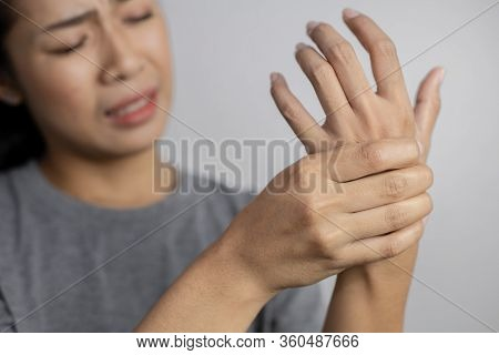 Woman Suffering From Pain In Hand.