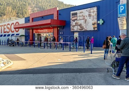Ruzomberok, Slovakia - April 8: People With Face Masks Standing In Front Of Shop. Social Distance Du
