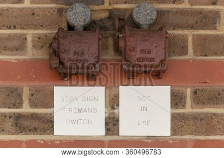 A Close Up View Of A Firemans Switch On The Side Of The Wall Of A Supermarket
