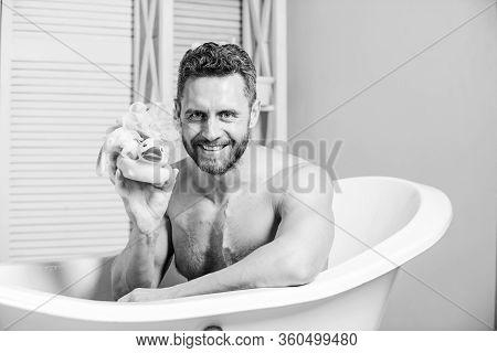 Macho Enjoy Bath. Sexy Man In Bathroom. Sex And Relaxation Concept. Man Wash Muscular Body With Foam