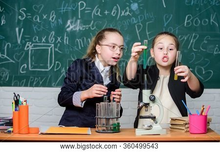Hard Choice. Chemistry Research. Biology Science. Happy Little Girls. Little Girls In School Lab. Sc