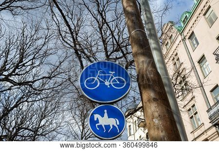 Blue Road Signs A Road For Cyclists And A Road For Riders On A Street In Stockholm.