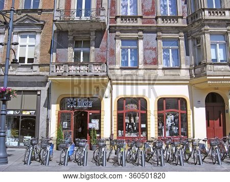 Lodz / Poland. 18 July 2019: View Of City Street With Many Bicycles. Urban Transport. Bicycles For R