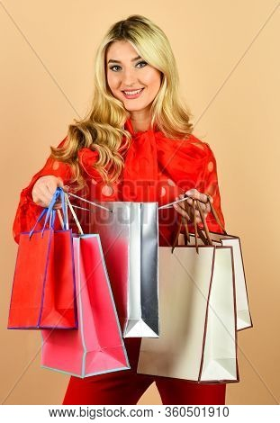Nice Purchase. Sexy Blonde Carry Shopping Bags. Elegant Woman Shopaholic. Girl Shopper Hold Paperbag