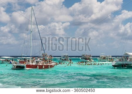 George Town, Grand Cayman Islands, United Kingdom - April 23, 2019: People Enjoy Playing With The St