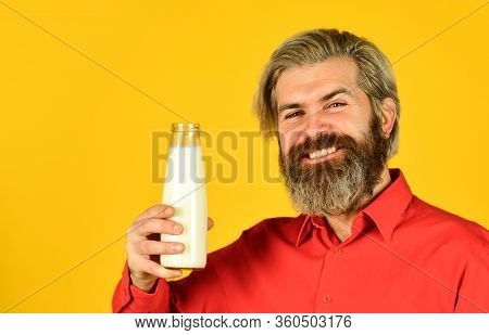 How To Be Dairy Free. Lactose Intolerance. Bearded Man Hold Milk Bottle. Pasteurized Milk. Vegan Mil