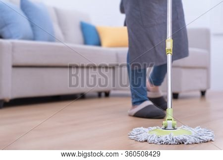 Mop Floors. Young Woman Washing Wooden Ground Floor At Home With A Mop, Cleaning Equipment, Concept